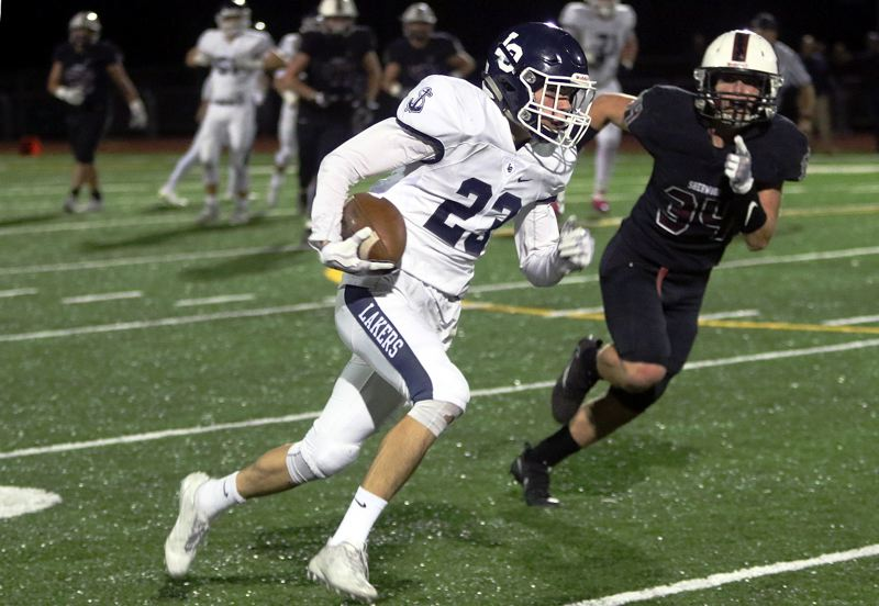 TIMES PHOTO: DAN BROOD - Lake Oswego's Joe Hutson races upfield during his team's Friday-night home win over Sherwood.