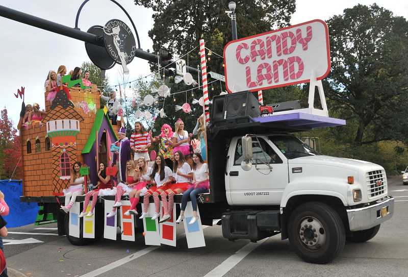 SPOKESMAN PHOTO: VERN UYETAKE  - Seniors ride their Candy Land theme float.