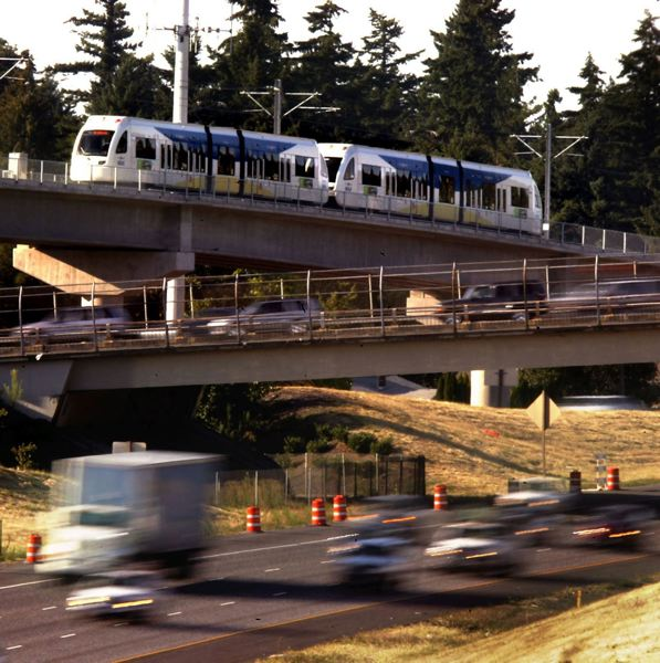 PORTLAND TRIBUNE FILE PHOTO - MAX ridership has kept pace with population increases because of the new lines TriMet has opened. Bus ridership has fallen, however.