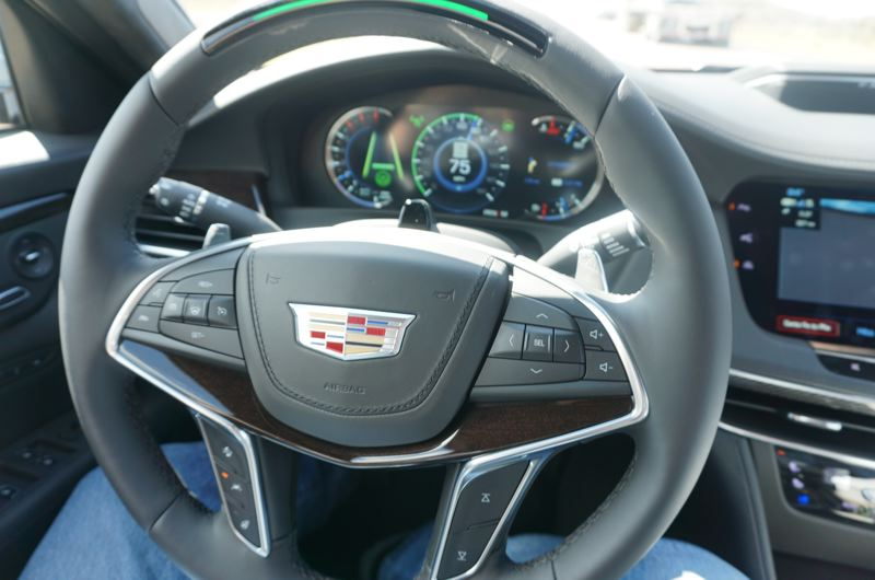 PORTLAND TRIBUNE: JEFF ZURSCHMEIDE - The driver information display and the top of the steering wheel glow green when the Super Cruise system is activated. You can remove your hands from the wheel and let the Cadillac drive itself.