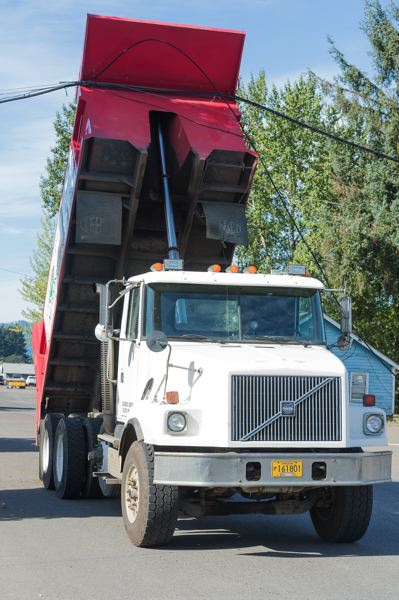 NEWS-TIMES PHOTO: CHRISTOPHER OERTELL - A dump truck incident took out five utility poles in Cornelius Monday morning.