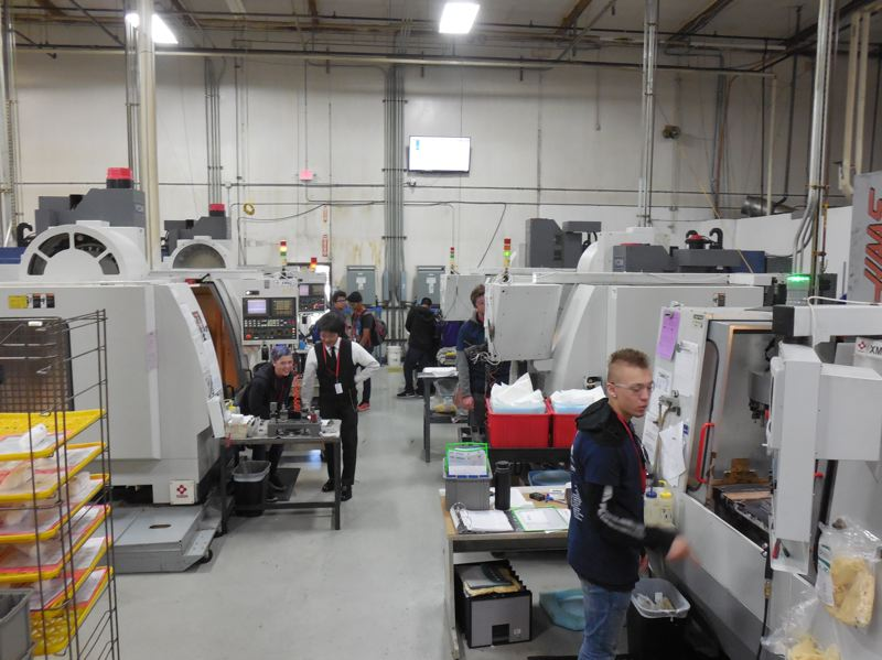 PAMPLIN MEDIA PHOTO: JOSEPH GALLIVAN - Students from Sunset High School check out the manufacturing facility at Tosoh Quartz.