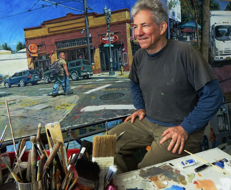 SUBMITTED PHOTO - Oregon City artist Dennis Anderson sits in his studio, surrounded by his paintings of urban neighborhoods. He is part of the Open Studios of Portland this weekend and next weekend.