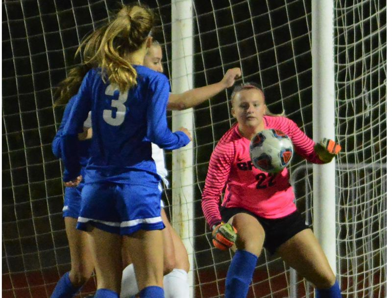 OUTLOOK PHOTO: DAVID BALL - Barlow goalie Lisa Martin keeps her eye on the ball during the first half of the Bruins' 3-2 win at Oregon City.