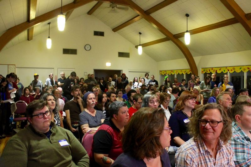 TRIBUNE PHOTO: LYNDSEY HEWITT - The room at Montavilla United Methodist Church was packed while others had to go into overflow rooms.