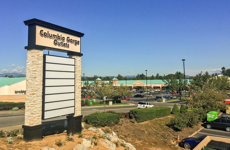OUTLOOK PHOTO: JOSH KULLA - The newly re-named Columbia Gorge Outlets are undergoing renovation, including a new look sign and new LED overhead lighting, which can be seen in the background.