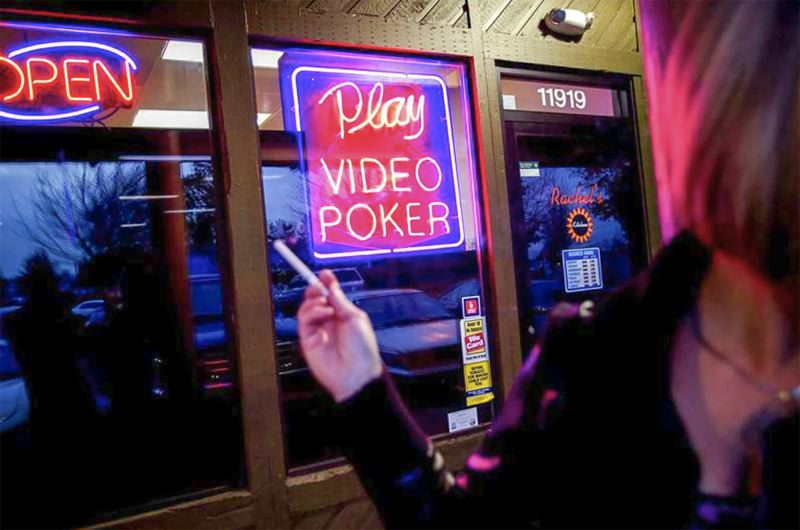 FILE PHOTO - Players spent nearly $140 million to earn approximately $100 million, according to an Outlook analysis of Oregon Lottery data.