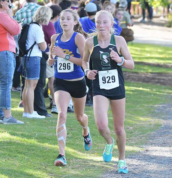 LON AUSTIN/CENTRAL OREGONIAN - Jan Carne runs side by side with Summit's Kelsey Washenberger. Carne finished 12th in the 153-person race, while Washenberger was 19th.