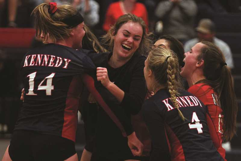 PHIL HAWKINS - The No. 5 Kennedy volleyball team celebrates during the team's 15-5 run in the final game of the Trojans' 3-2 rally against the No. 4 St. Paul Buckaroos on Thursday.