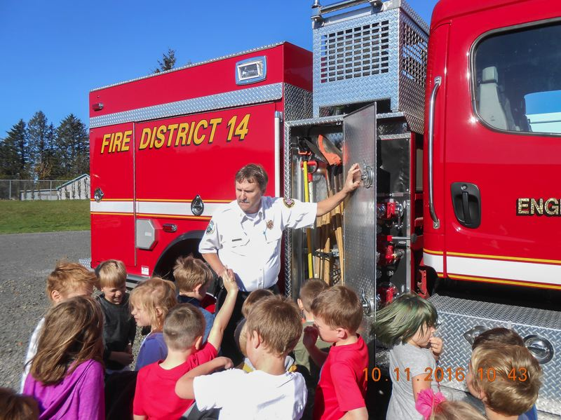 CONTRIBUTED PHOTO: CORBETT FIRE  - Curious Corbett students inspect a fire engine on October 11 in 2016.