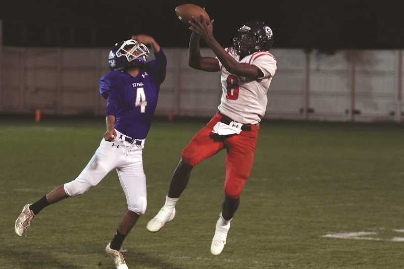 PHIL HAWKINS - Below, Kennedy sophomore Emorej Lynk catches one of his game-high four receptions.