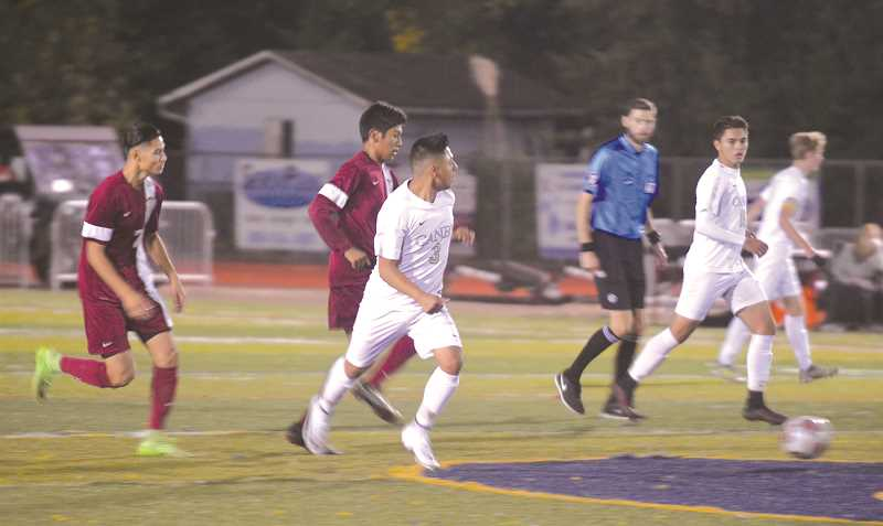 HERALD PHOTO: TANNER RUSS - Canby senior Kristopher Lopez leads a counterattack against the Tualatin Timberwolves. The Cougars drew with the visiting team 2-2 to end an eight game losing streak.