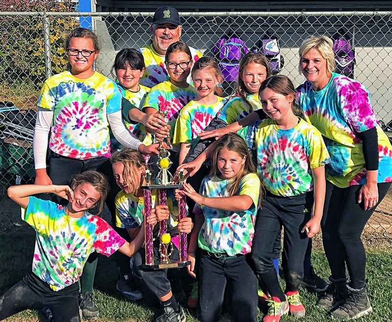 SUBMITTED PHOTO - The West Linn Softball 10U Rainbow Warriors pose with their trophy after a second-place finish in the 10U Gold Bracket.
