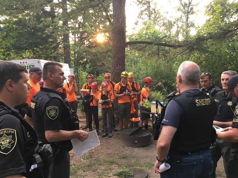 SUBMITTED PHOTO: GITTE VENDERBY - The MCSOSAR team receives instructions from Multnomah County Sheriffs Department deputies during a search in earlier this year.