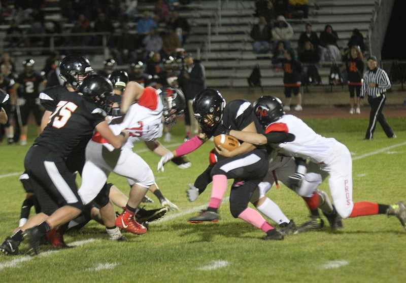 WILL DENNER/MADRAS PIONEER - The Bulldogs were unable to do much on the ground against Grant Union's stout run defense last Friday, so they instead switched to pass-heavy playcalling.