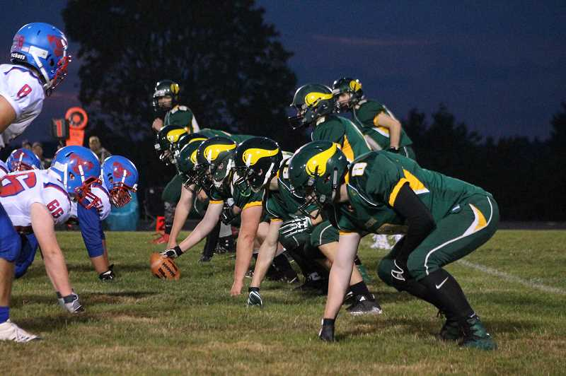 PIONEER PHOTO: CONNER WILLIAMS - Colton's offense lines up against Central Linn earlier this season.