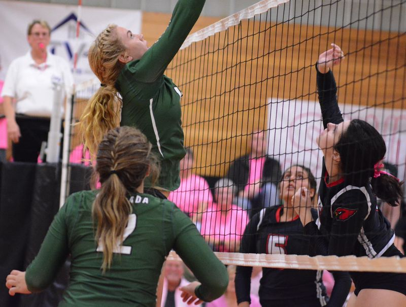 ESTACADA NEWS: DAVID BALL - Estacadas Trinity Gach goes up for a block out of the middle during the Rangers' three-set loss at Corbett last week.