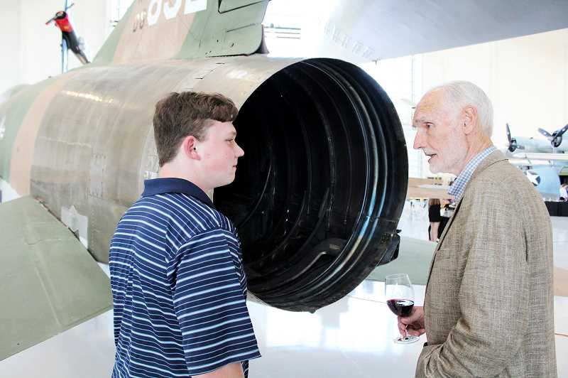 SUBMITTED PHOTO - Gen. Merrill A. 'Tony' McPeak talks with 16-year-old John Bales during a recent event at the Evergreen Aviation and Space Museum. Bales received a personal aviation lesson on the F-100 Super Sabre from McPeak; it's the same model of aircraft the general flew during the Vietnam War.