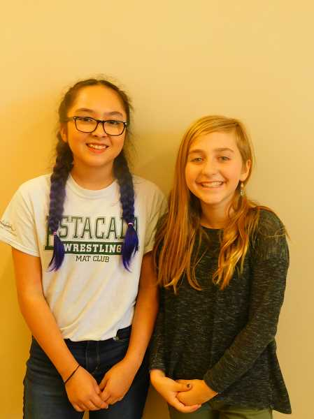 ESTACADA NEWS PHOTO: EMILY LINDSTRAND - Estacada Middle School students Jazmyn Seely and Calla Baker helped organized the schools pet food drive.