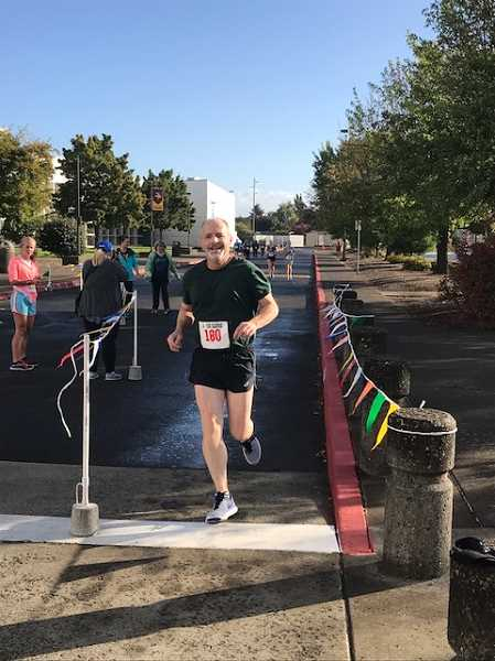 COURTESY PHOTO - Pastor Dan Thompson-Aue of the Forest Grove United Methodist Church smiles as he crosses the finish line.