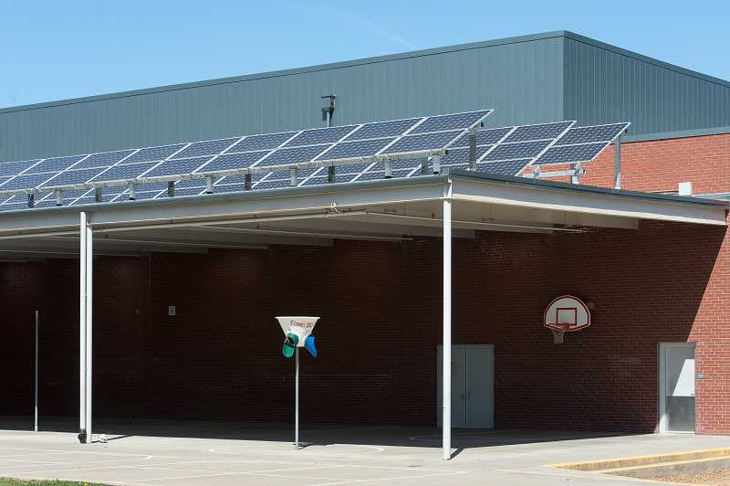 NEWS-TIMES PHOTO: CHRISTOPHER OERTELL  - Solar Panels outside Joseph Gale Elementary School generate about 15 percent of the school's power.