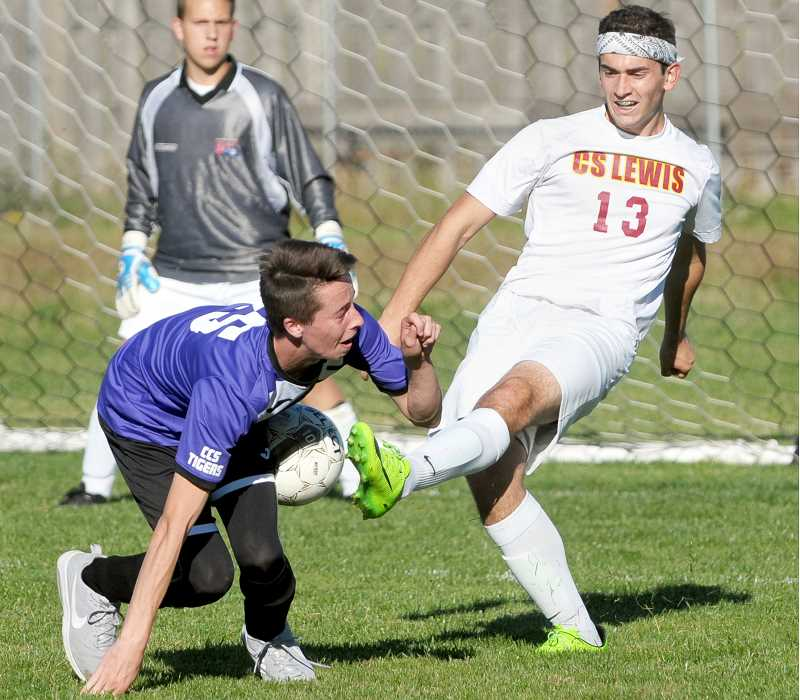 SETH GORDON - Trever Ambrose's clearance attempt strikes a Central Christian player during C.S. Lewis Academy's 6-2 home win Oct. 5. It was the Watchmen's first league win of the season.