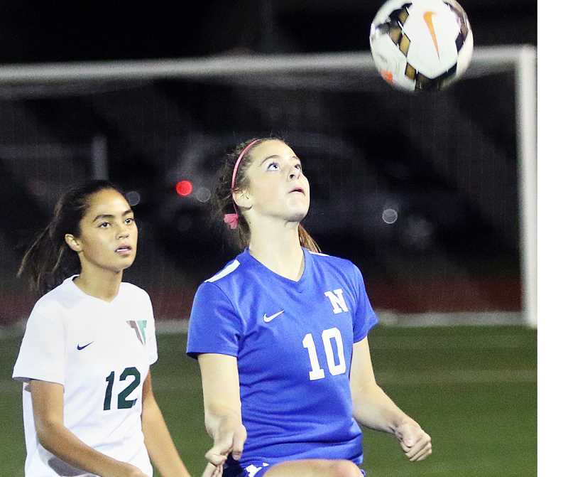 DAN BROOD -- TIGARD/TUALATIN TIMES -  Abby Durrell prepares to volley the ball during Newberg's 2-2 tie at Tigard Oct. 4.