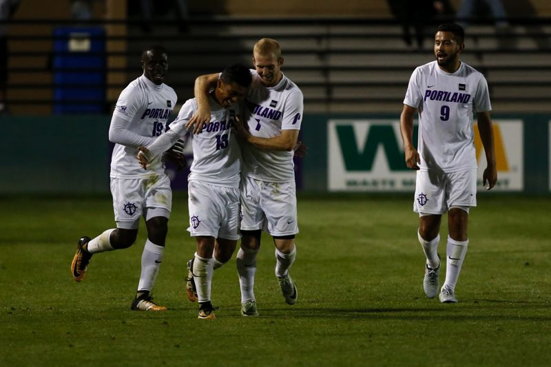 COURTESY: UNIVERSITY OF PORTLAND - Rey Ortiz is congratulated after his free-kick goal vs. Pacific by University of Portland teammates Benji Michel (left), Matthew Coffey (second from right) and Jason Romero.