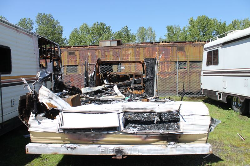 TRIBUNE PHOTO: LYNDSEY HEWITT - Some RVs parked in neighborhoods have caught on fire due to bad electrical wiring and other issues. This one parked at a full lot at Sergeants Towing in the spring was nearly demolished.