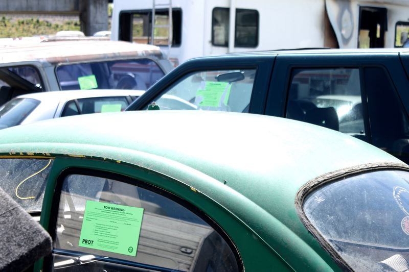 TRIBUNE PHOTO: LYNDSEY HEWITT - PBOT puts these green stickers on cars before they're towed away.