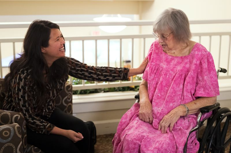 TIMES PHOTO: JAIME VALDEZ - Audrey Lundin, nurse practitioner with Landmark Health, laughs at one of Betty Hiner's jokes. Lundin's job is to travel around the region visiting patients like Hiner where they live and providing basic in-home care.