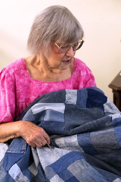 TIMES PHOTO: JAIME VALDEZ - Betty Hiner, who lives at an assisted living facility just outside Tigard, makes quilts from old pairs of jeans for family members who come to visit her.