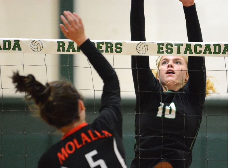 ESTACADA NEWS: DAVID BALL - Estacadas Trinity Gach puts up a block against Molallas Georgia Hunter during the Rangers three-set sweep last week.