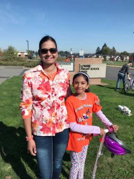 CONTRIBUTED PHOTO - Fifth-grader Pragya Kollu (right) and her mom, Divya Kollu (left), participate in the annual Wheel A Thon fundraiser.