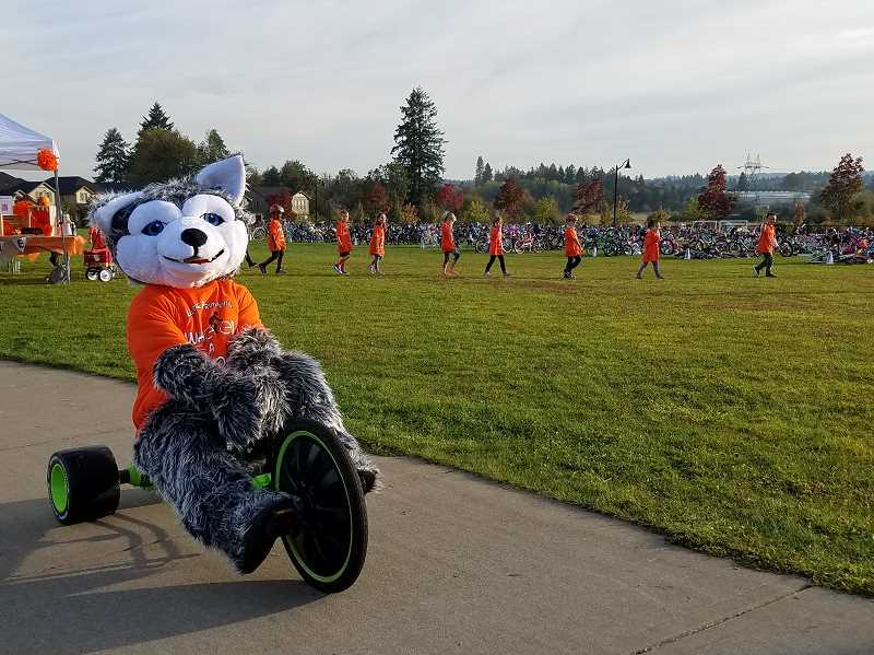 CONTRIBUTED PHOTO - Lowrie Primary's wolf mascot wheels to the start line as the kindergarten classes get ready to wheel.