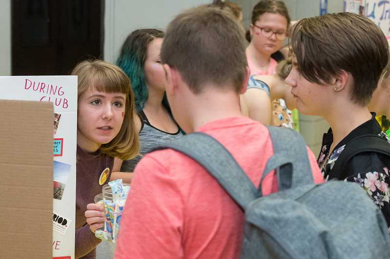 NEWS-TIMES PHOTO: CHRISTOPHER OERTELL - Heather Monahan speaks to a fellow student about the club.