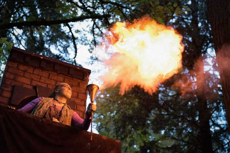 SUBMITTED PHOTO  - Each year West Linn Parks and Recreation staff and volunteers create the Haunted Trail at Mary S. Young Park. The forest is filled with spooky characters like this fire breather.