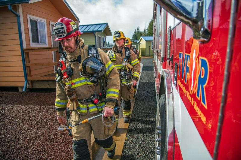 COURTESY OF TUALATIN VALLEY FIRE & RESCUE - A full hazmat team arrives at a site, having been called out because the likelihood of hazardous material on the scene.