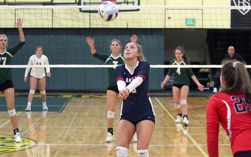 REVIEW PHOTO: MILES VANCE - Lake Oswego's Olivia Salita passes the ball during her teams three-set loss at West Linn High School on Oct. 5.