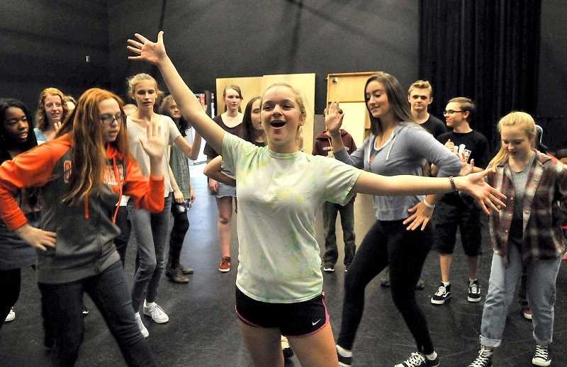 REVIEW PHOTO: VERN UYETAKE - Lake Oswego High student Julie Wolfe, who plays Janet Van De Graaff, rehearses a scene with her castmates from 'The Drowsy Chaperone.'