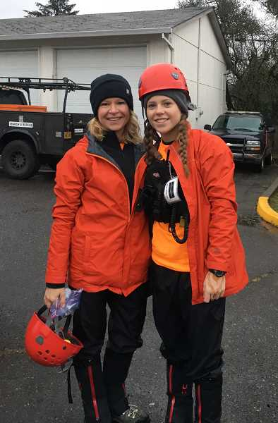 SUBMITTED PHOTO: GITTE VENDERBY - Gitte (left) and daughter Andrea Venderby are all geared up and ready go on a search-and-rescue mission with the Multnomah County Sheriff's Office Search and Rescue team. The pair have given more than 400 hours to training and missions over the past year.