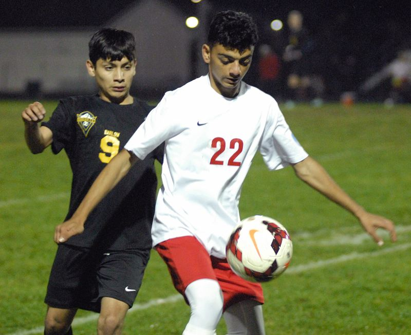 GRESHAM OUTLOOK: MATT RAWLINGS - Centennial's Najib Tajik gains possession of the ball.