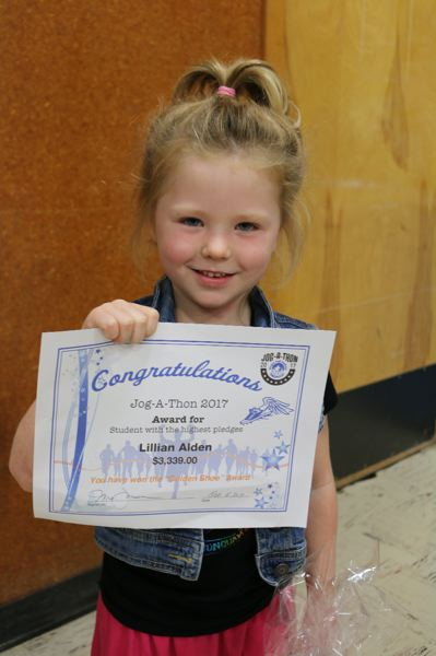 CONTRIBUTED PHOTO - Lilian Alden with her award for gaining the highest number of pledges in the Oregon Trail Academy's Jog-A-Thon.