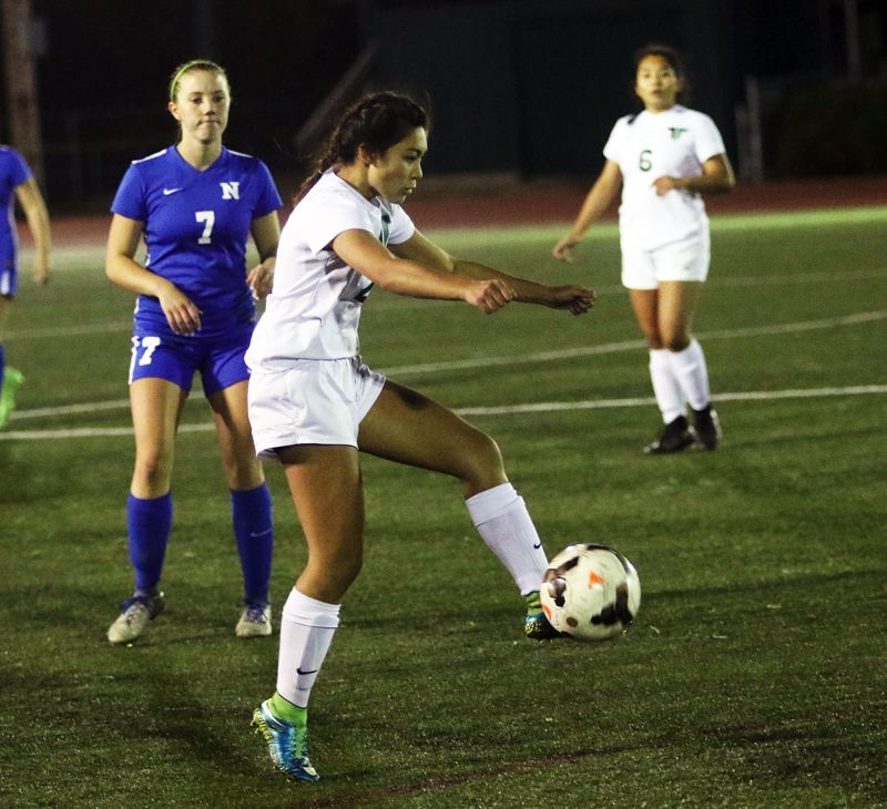 DAN BROOD - Tigard senior defender Kyra Medgin controls the ball during the Tigers' match with Newberg.