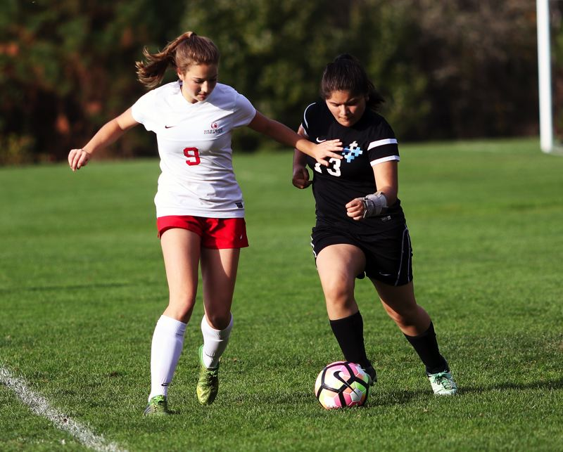 DAN BROOD - Westside Christian freshman Kaia Lunz (left) battles a De La Salle North player for the ball in Monday's match.