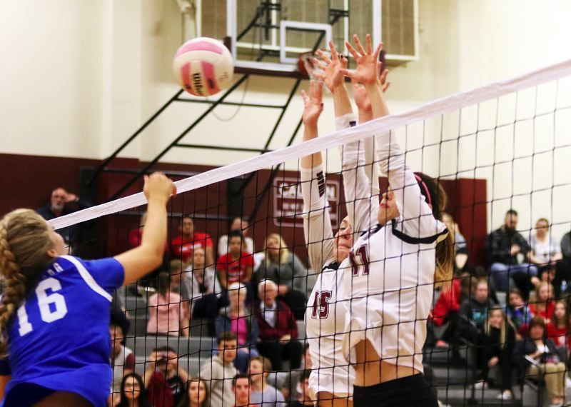 DAN BROOD - Sherwood junior Alyssa Haslip (15) and sophomore Claire McGill go up at the net during the win over Newberg.