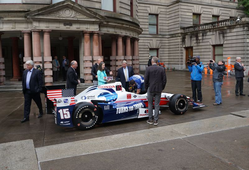 PORTLAND TRIBUNE: JEFF ZURCHMEIDE - Portland officials including Parks Commissioner Amanda Fritz inspected Graham Rahal's IndyCar outside City Hall after Friday's announcement.