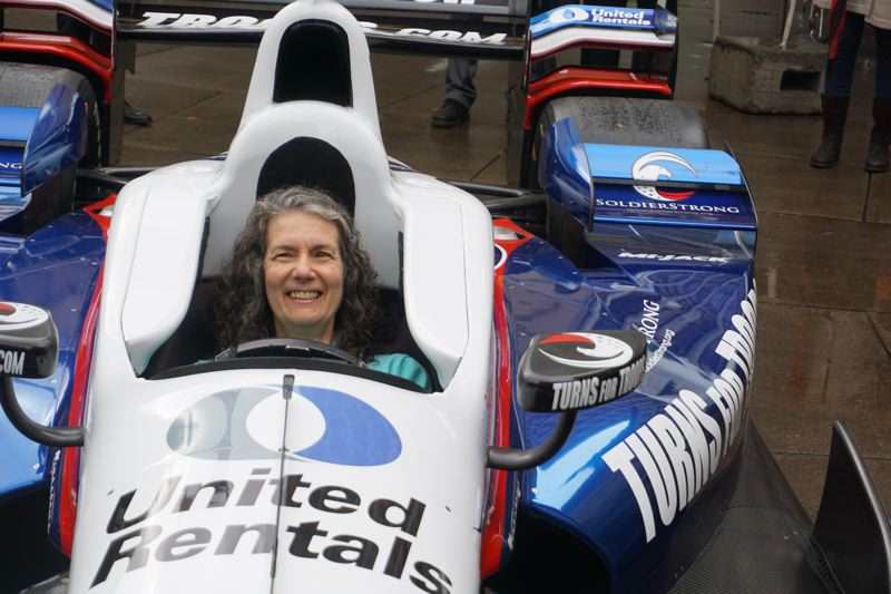 PORTLAND TRIBUNE: JEFF ZURSCHMEIDE - Parks Commissioner Amanda Fritz sat in the IndyCar raced by Graham Rahal after the press conference.
