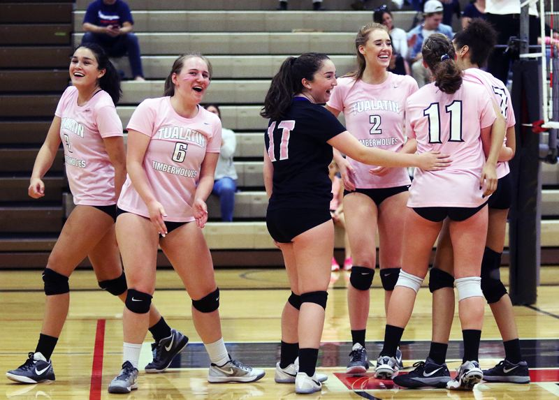 DAN BROOD - The Tualatin High School volleyball team, including, from left, Olivia Ashley, Emily Friesen, Sofia Ashley, Rylan Sornson, Jackie Phillips and Tasha Loudd is all smiles during the four-set win over Canby in last week's Three Rivers League match.