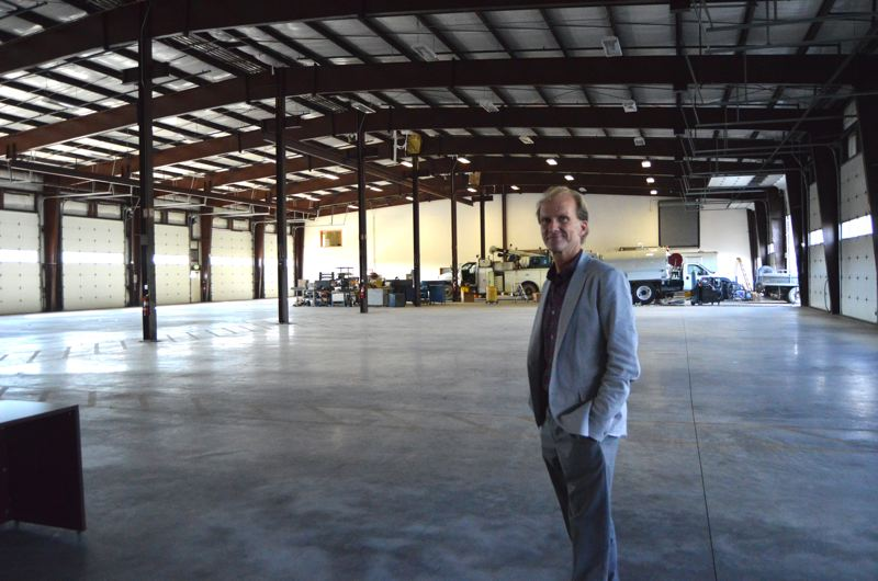SPOTLIGHT PHOTO: COURTNEY VAUGHN - Mike Myers, OIT professor and OMIC executive, shows off a warehouse space that will eventually house industrial machines and apprentice workers. The current OMIC building in Scappoose is filled with office spaces slated to be converted.